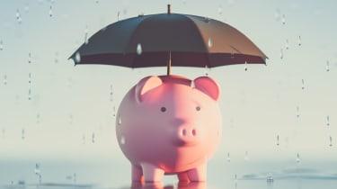 Concept art showing a piggy bank under an umbrella in the rain
