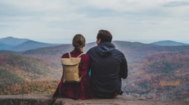 A couple of hikers take in a view.