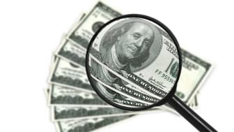picture of money under a magnifying glass