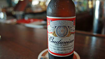 NEW YORK - JUNE 13: A bottle of Budweiser beer is displayed at a bar June 13, 2008 in New York City. The Belgian-Brazilian brewer InBev has made an offer of $46.3 billion bid for Anheuser-Bus