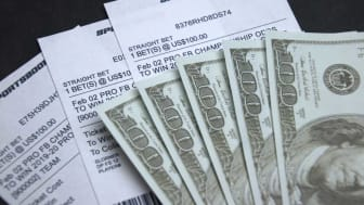 picture of sports betting tickets and cash