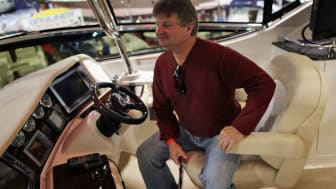 MIAMI BEACH, FL - FEBRUARY 11: John Lanehart checks out a boat being sold by MarineMax during the 69th annual Miami International Boat show on February 11, 2010 in Miami Beach, Florida. The f