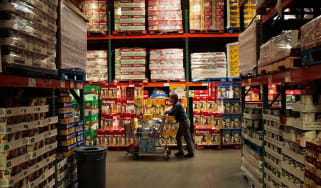 TUCSON, AZ - APRIL 4:A shopper pushes a cart through the aisles of a Costco store April 4, 2008 in Tucson, Arizona.As the American economy slows down, consumers are increasingly turning to th