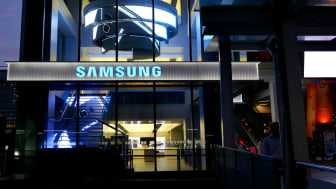 Bangkok, Thailand – November 10, 2015: Exterior view of a Samsung shop in the Siam Square area of Bangkok, Thailand. People walk around the area. The picture is taken from the walkway of sky