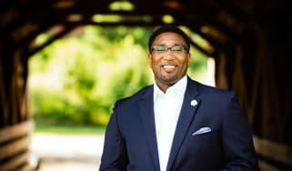Portrait of financial professional Malik S. Lee