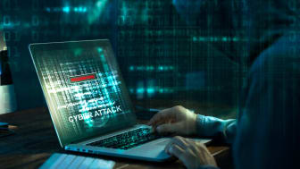 Computer hacker. Internet crime working on a code on laptop screen with dark digital background. Cyber attack in cyberspace concept