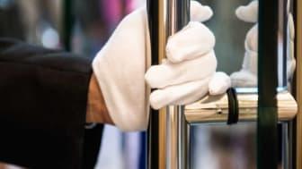 Gloved hand grabbing door