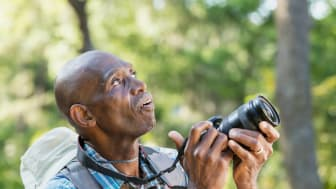 A retiree taking pictures outside