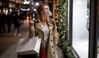 picture of woman window shopping for holidays with mask on