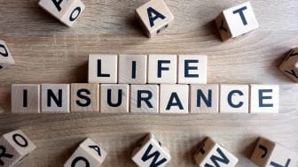 Life insurance text from wooden blocks on desk