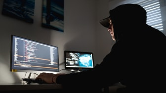 picture of hacker at his computer