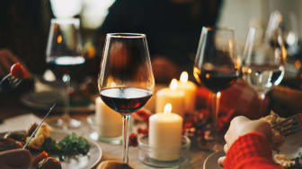 Glasses of wine on a dinner table decorated for the holidays