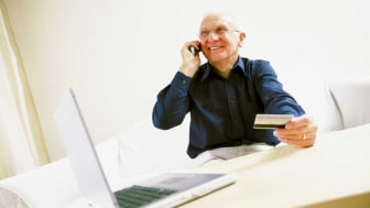 picture of man calling to activate a card