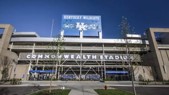 Exterior entrance of the University of Kentucky Wildcats football stadium with blue and white banner.