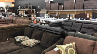 Furniture for sale inside a Big Lots store