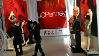 """NEW YORK - MARCH 03:Customers walk through the new J.C. Penney 15,000-square foot temporary promotional store, or """"pop-up"""" store, in Times Square March 3, 2006 in New York City. Part of the b"""