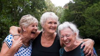 Three retirees socializing