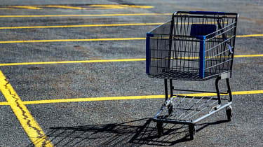 An abandoned shopping cart in a parking lot
