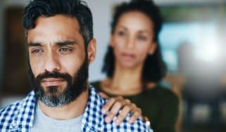 Woman comforting distraught man.