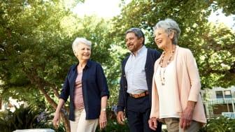 Three adults tour a facility