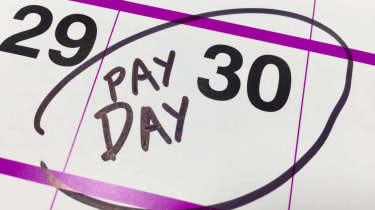 """Photo of calendar day with """"Payday"""" written on it"""