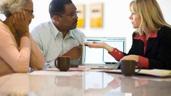A woman consults a senior couple