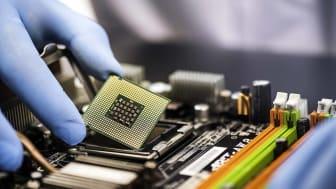 person inserting microchip into device