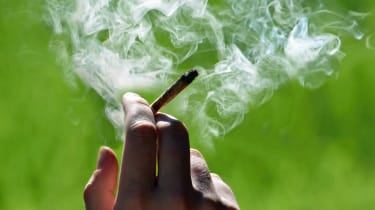 Marijuana joint in the hand, drugs concept