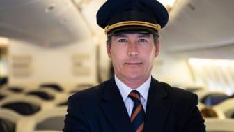 A pilot on a plane.