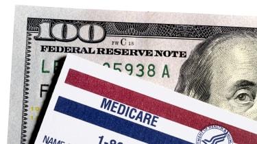 $100 bill underneath medicare card
