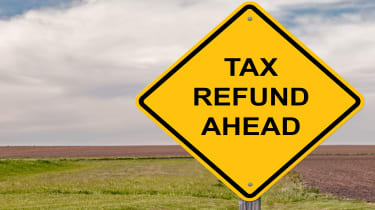 """picture of yellow road sign saying """"Tax Refund Ahead"""""""