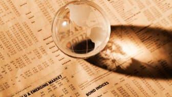 globe on stock newspaper