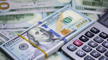 Success and got profit from business with many one hundred american dollar currency,money with calculator,Focus on eye of Franklin