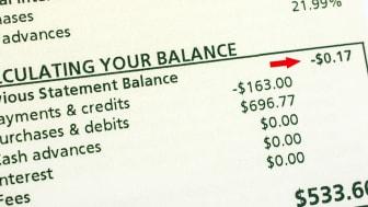 Credit card statement balance showing a small credit amount- balancing your statement.