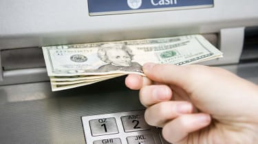 Person taking money out of an ATM