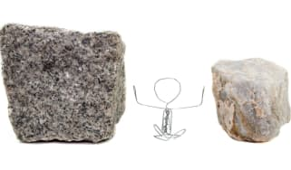 Photo illustration of a stick figure stuck between two rocks
