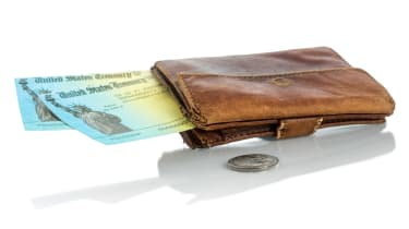 picture of old wallet with two government checks sticking out of it