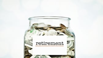 Glass jar filled with savings for retirement