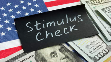 "picture of flag, money, and sign saying ""stimulus check"""