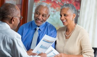 A couple meets with a financial planner to discuss annuities.