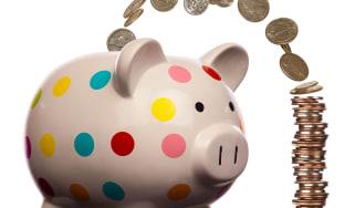 Money flows into a piggy bank