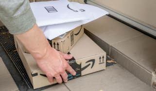 Amazon delivery of a stack of packages to a front porch
