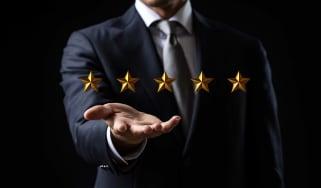 concept art of man holding five stars