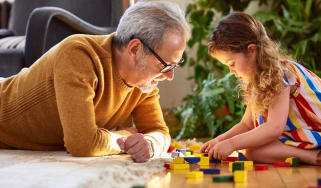 Man playing a game with a grandchild