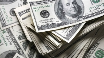 Many wads of $100 bills