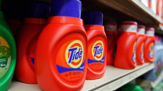 Several bottle of Tide sit on a grocery-store shelf