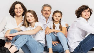 picture of family of mother, father, and three children