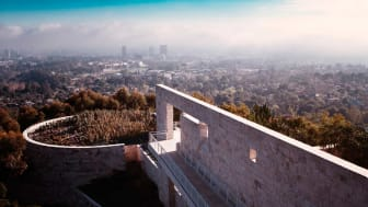 A museum on top of a hill overlooking a city