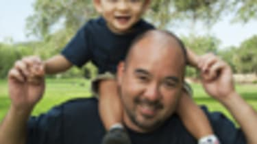Asian son and father, riding piggyback