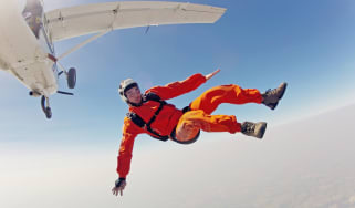 A skydiver takes a dangerous plunge.
